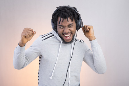Man listening to music and dancing Stock Photo