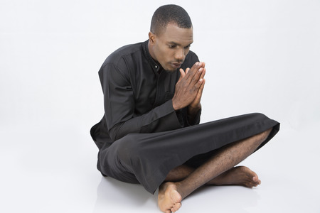 clasped hands: Man with clasped hands and crossed legs