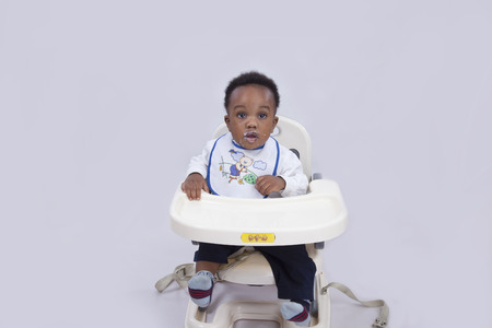 6 12 months: A lovely baby sitting in a baby walker