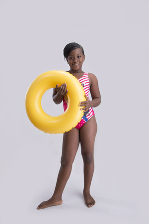 swimming to float: A pretty girl posing and holding a swimming float Stock Photo