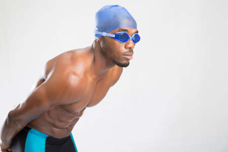 fits in: A  male swimmer in an isolated background. Stock Photo