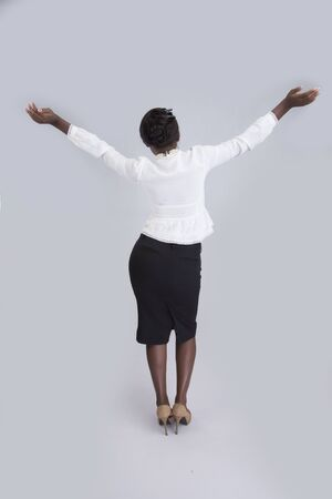 25 29 years: Rear view of a businesswoman with both hands raised