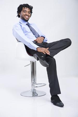 fair skin: Portrait of businessman sitting with leg crossed