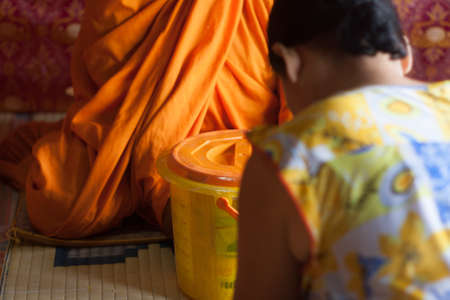 Buddhist women offer the necessities to the monks.