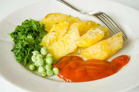 browned: Tasty baked potatoes with herbs in the plate