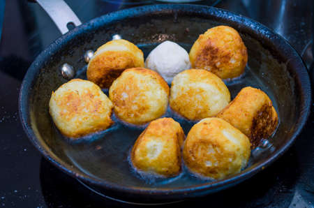 Cottage cheese donuts are fried in a skillet photo