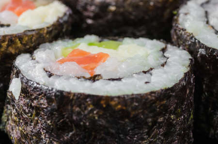 Japanese sushi made with rice, fish and seaweed with ginger and wasabi Stock Photo