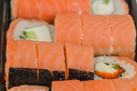 appropriately: Sushi is a classic Japanese snack made from finely chopped fish fillets, usually raw, less smoked, vegetables, seafood, appropriately boiled rice, sometimes wrapped in algae noria