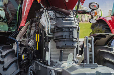 mounted: Powerful high-tech tractor engine in modern design, mounted on a frame with an open hood Stock Photo