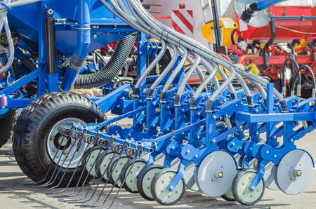 Agricultural cultivator for the processing of land, when used