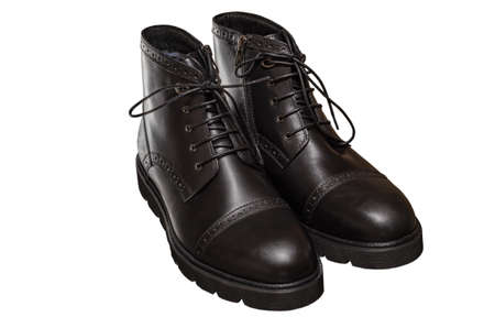 high black winter boots with lacing and lock on the thick sole, of leather and fur, comfortable and warm in the cold season Stock Photo