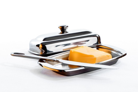 restraining device: Butter for a pasting on bread lies in special ware with a demountable cover