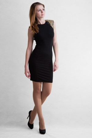 utmost: Young girl blonde in black short dress to utmost high-heeled Stock Photo