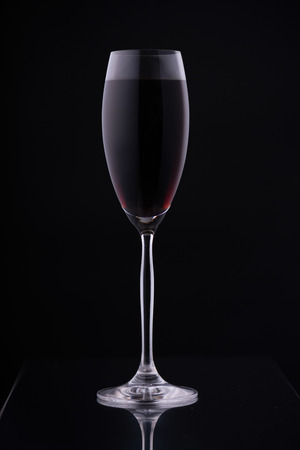 pinot grigio: Glass with a long leg on a black background Stock Photo