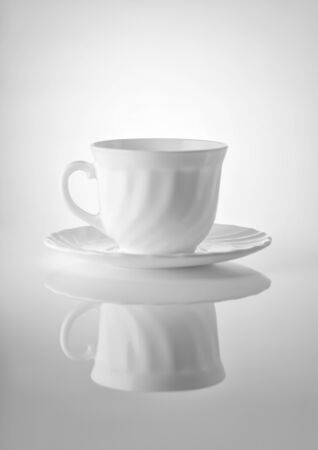 saucers: Cups for tea with saucers on a white background