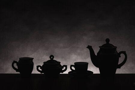 nonuniform: Dark silhouettes of ware for coffee on a gradient non-uniform background Stock Photo