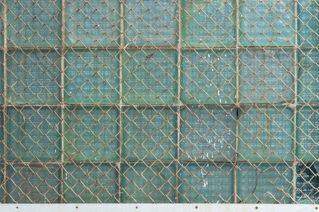 Background from the metal gauze of the chain-link and glass blocks