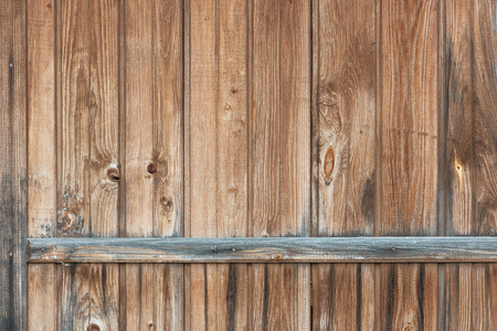 Background in style a rustic from old vertical wooden unpainted boards