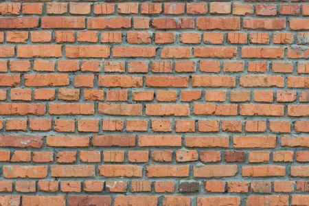 Background from the red brick laid with cement mortar