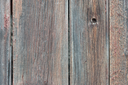 Background in style a rustic from old wooden unpainted boards with cracks
