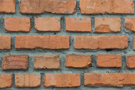 Фон из красного кирпича, заложенного цементным раствором, закрыть