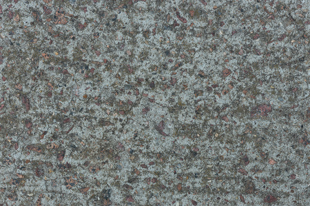 Background from concrete with impregnations from red granite gravel