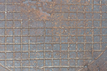 Background from rusty cast iron with the checkered relief drawing