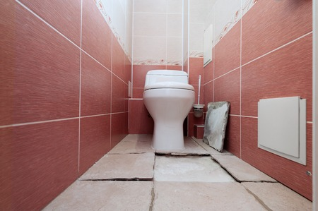 Destruction of a ceramic covering of a floor at violation of technology of repair in a toilet