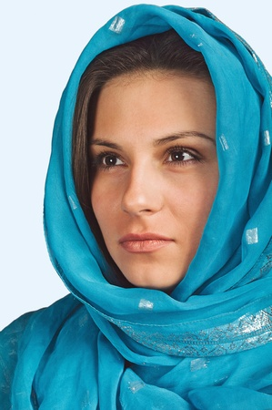 Portrait of a girl in a blue scarf photo