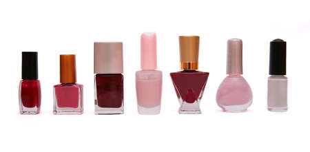 Set of nail polishes on white. photo