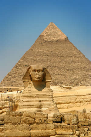 Egyptian sphinx and pyramid in Cairo. Stock Photo
