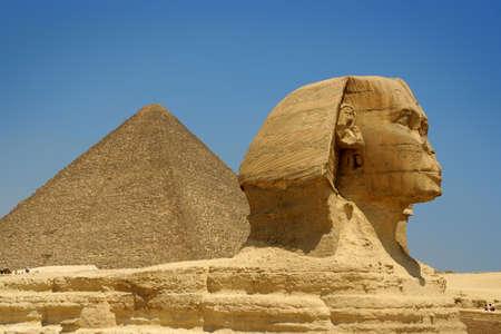 chephren: Egyptian sphinx and pyramid in Cairo. Stock Photo