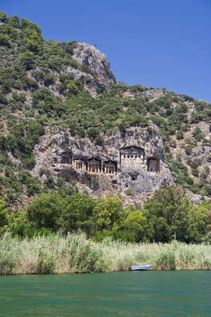 Ancient tombs on the rock. Turkey photo