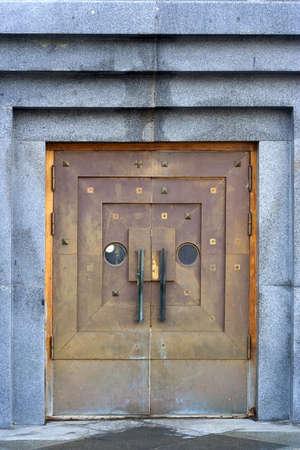 Metal doors in the granite wall Stock Photo - 16025252