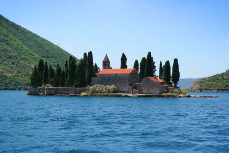 Little island in the middle of Kotor Bay, Montenegro photo
