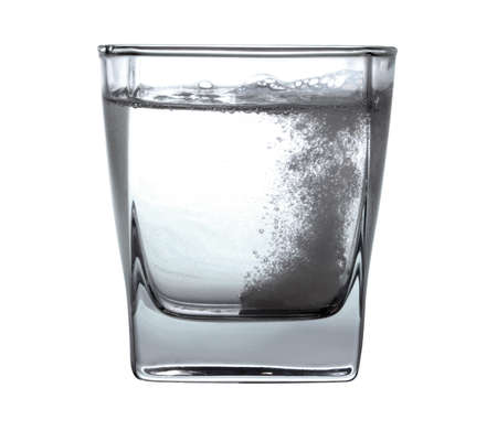 Pill in glass of water Stock Photo - 16553565