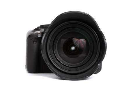 Digital SLR camera isolated on white Фото со стока