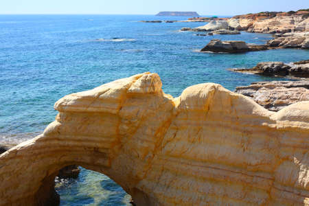 Rocky coastline next to Pafos, Cyprus photo