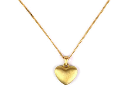 Golden heart pendant isolated on white Фото со стока