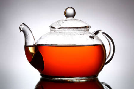 teapot: Glass teapot on gray background Stock Photo