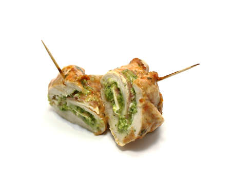 Chicken rolls filled with pesto, ham, cheese and backed in tomato sauce Stock Photo