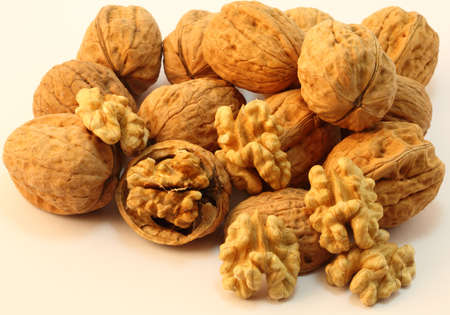 Beautiful arrangement of walnut with different structures and sizes showing the nut and the shell  Stock Photo
