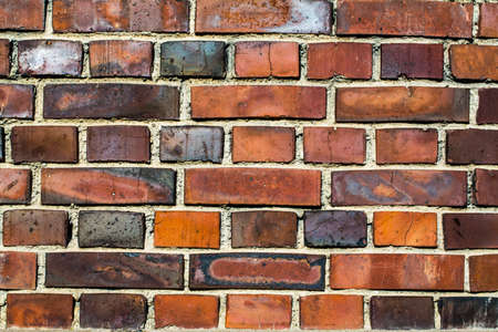 Colorful brick wall made of clay stones and mortar