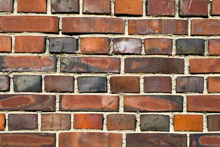 Colorful brick wall made of clay stones and mortar Stock Photo - 18266840