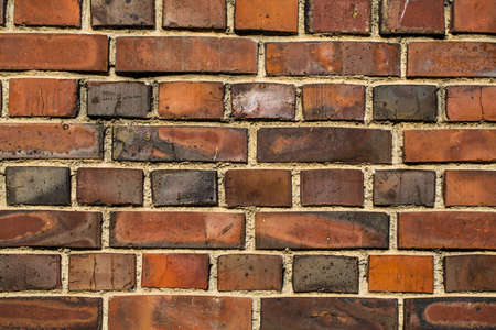 Colorful brick wall made of clay stones and mortar   Stock Photo - 18266842