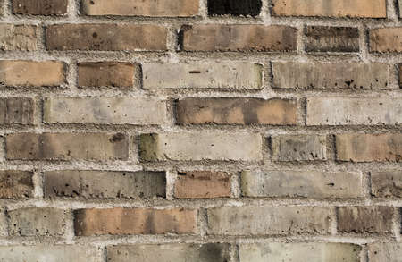 Colorful brick wall made of clay stones and mortar   Stock Photo - 18266848