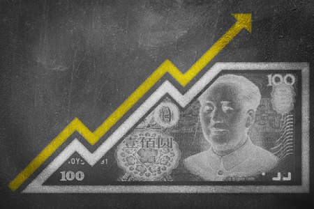 emerging economy: A money bill drawn on a chalk board looking like a growth graph with an upwards pointing arrow symbolizing economic relationships.