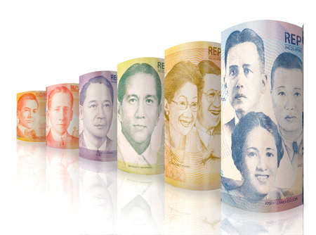 Different money bills standing next to each other forming a row that is declining in size and value.