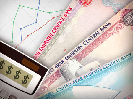emerging economy: Three money bills in front of sheet of paper with a graph on it symbolizing economic relationships.