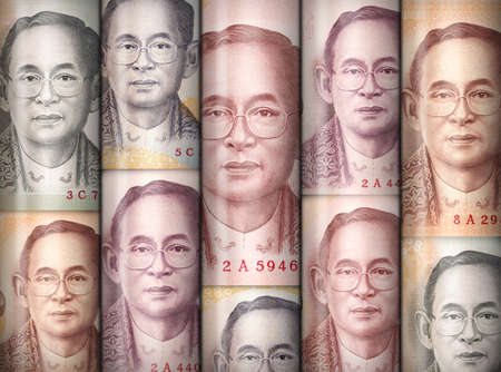emerging markets: Different money bills stacke over each other forming a money wall.